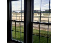 FF observing arena activities from lounge/ tack room windows