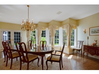 Formal Dining Room with Fireplace and Custom Windows