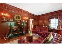 Mahogany Paneled walls with built-ins and Fireplace